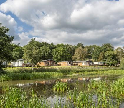 Lake edge luxury holiday lodges overlooking Park Pool at Pearl Lake, Herefordshire