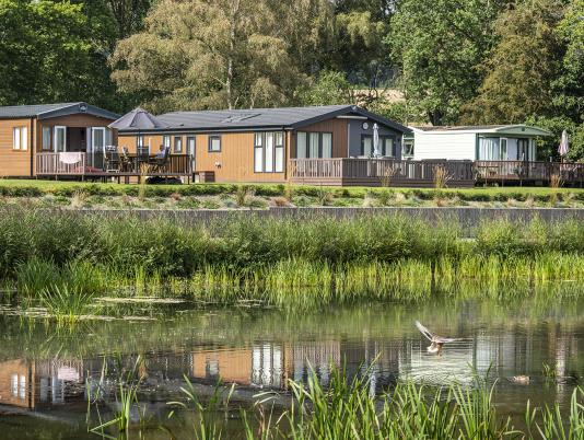 Luxury lodges overlooking the lake at Pearl Lake, Herefordshire