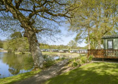 Lake edge caravan holiday home pitches at Pearl Lake